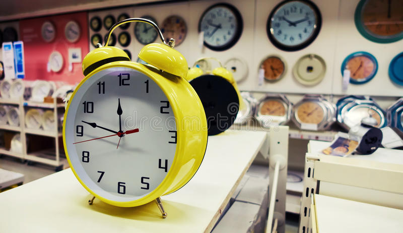 Alarm clock. In store. Clocks on sale in shop supermarket royalty free stock photography