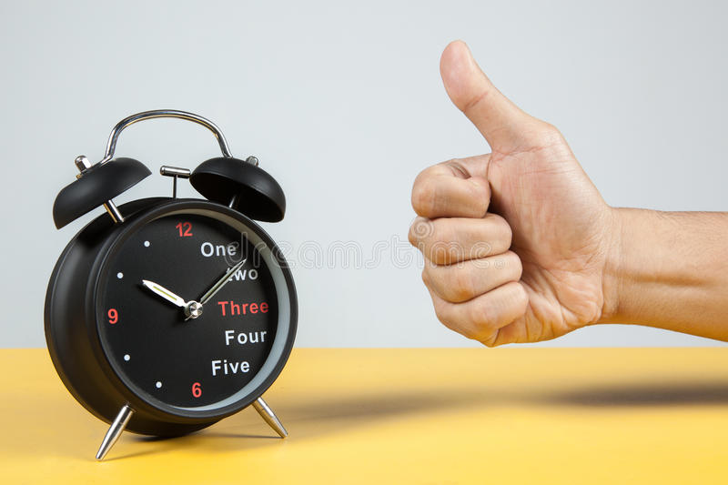 Alarm Clock with Success Sign royalty free stock images