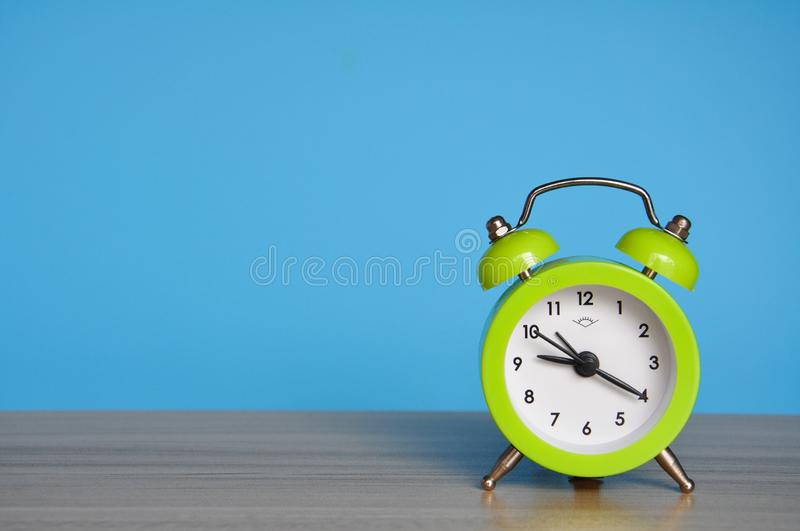 The alarm clock on the table royalty free stock photos