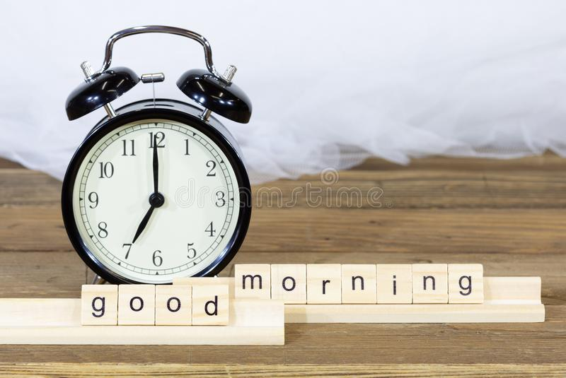 Alarm clock. To sound at 7 o`clock stock image