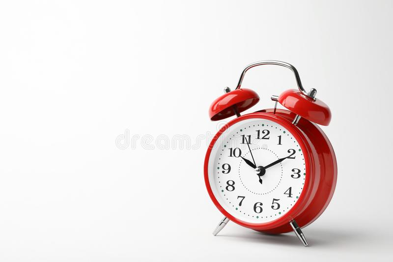 Alarm clock on white background. Time concept royalty free stock photography