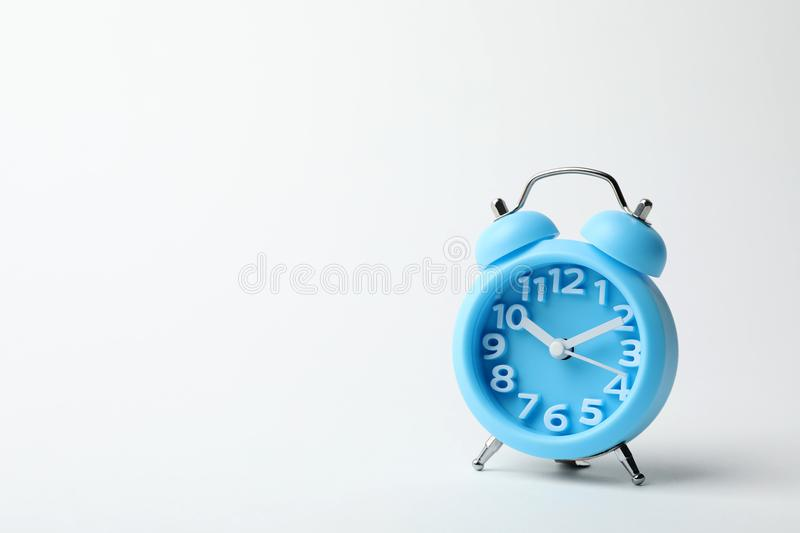Alarm clock on white background. Time concept royalty free stock image
