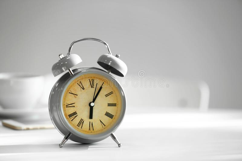 Alarm clock on white table stock image