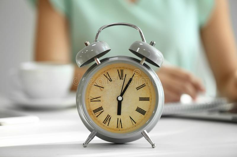 Alarm clock on white table royalty free stock image