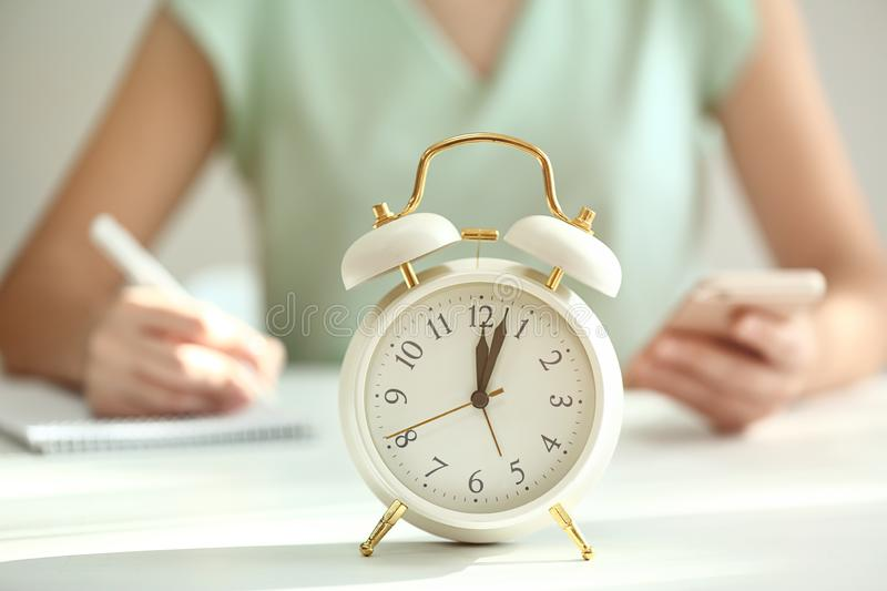 Alarm clock on white table royalty free stock photo
