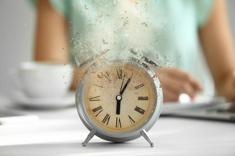 Alarm clock on white table stock photo