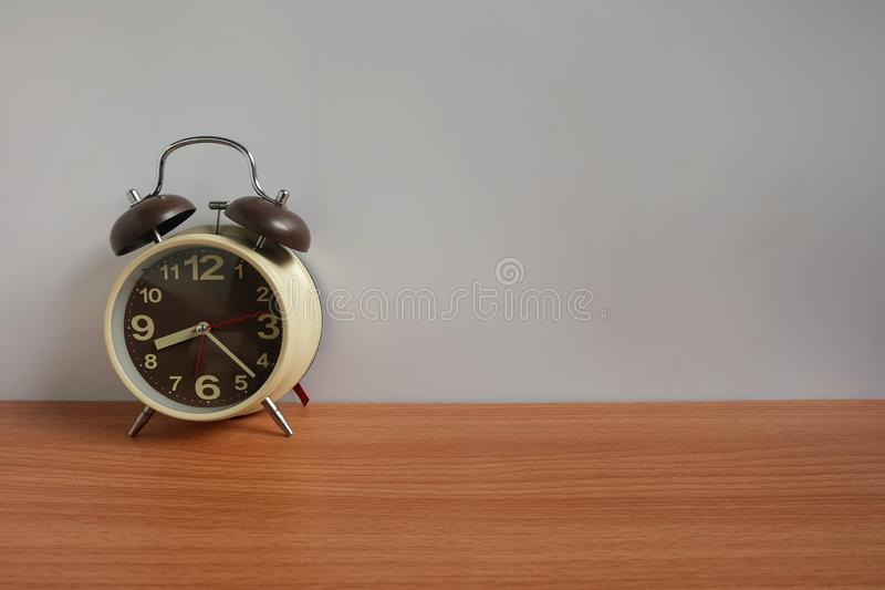 Alarm clock on wooden floor and White background with copy space, Morning wake up royalty free stock images
