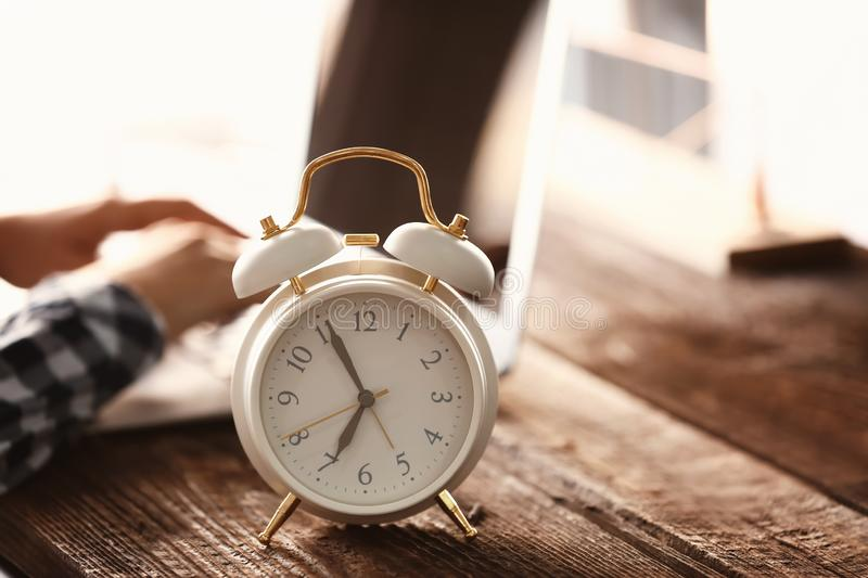 Alarm clock on wooden table stock images