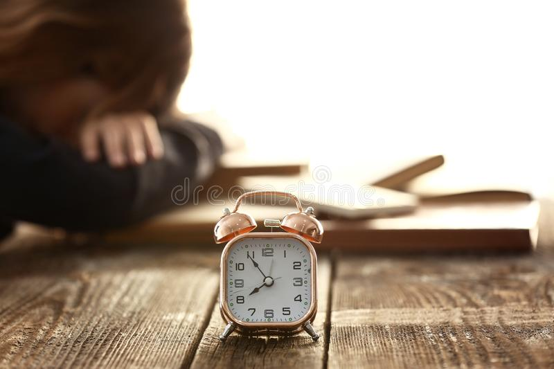Alarm clock on wooden table stock photo
