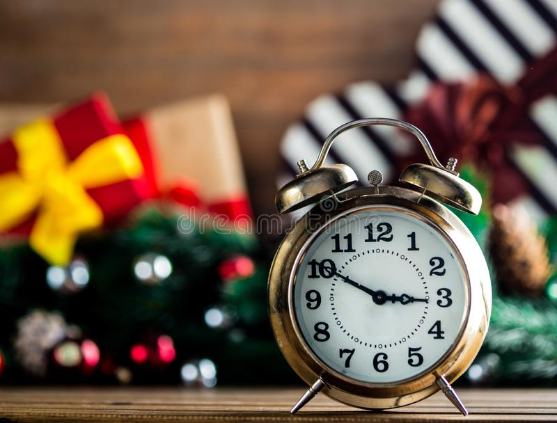 Alarm Clock On Wooden Table With Christmas Gifts Stock ...