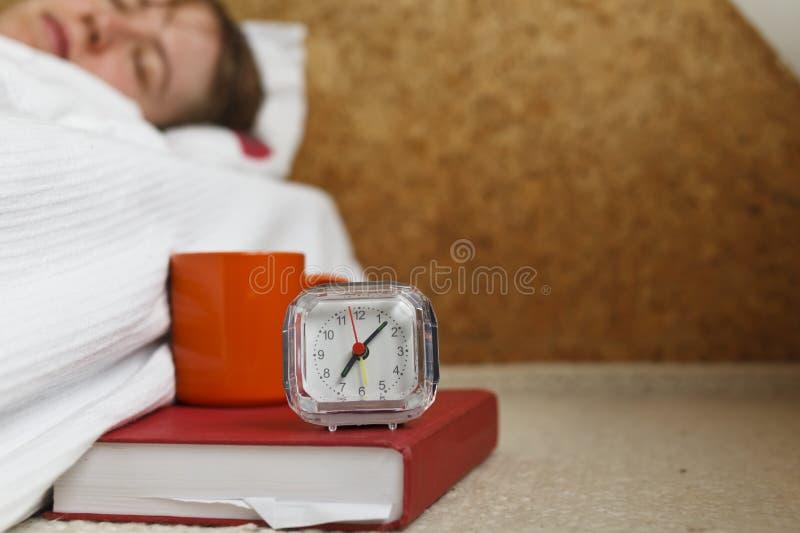 Alarm, coffee and sleepy head stock images