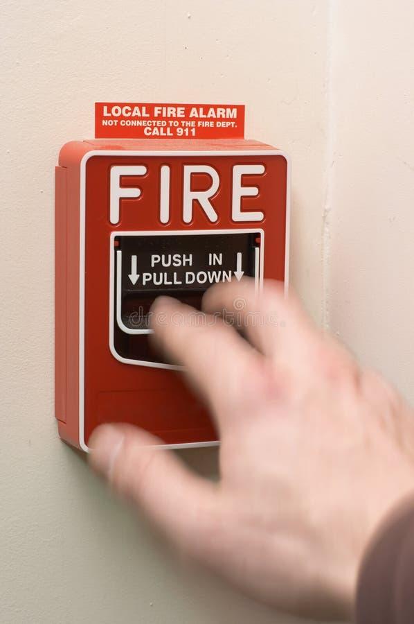 Alarma de incendio que es tirada imagenes de archivo