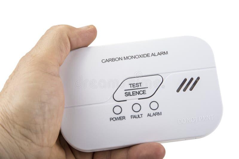 Alarma del monóxido de carbono para el sueño seguro en blanco imagenes de archivo