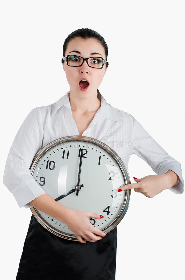 Alarmed, shocked business woman holding a large clock. White iso stock image
