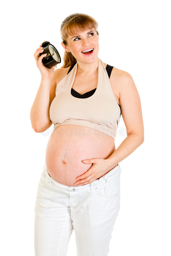alarmet behandla som ett barn den gravida klockan som långt rymmer arkivbild
