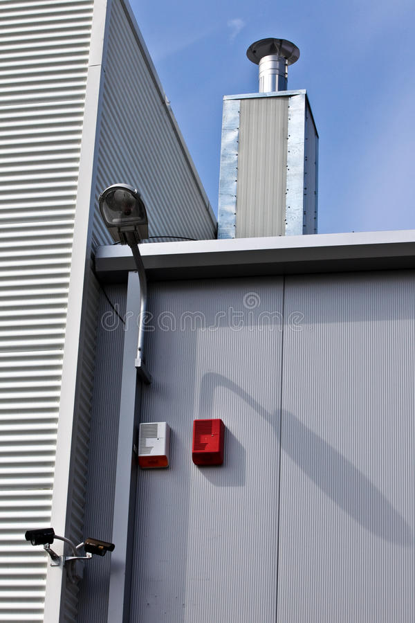 Alarms. Fire and burglar alarms on a building royalty free stock photography
