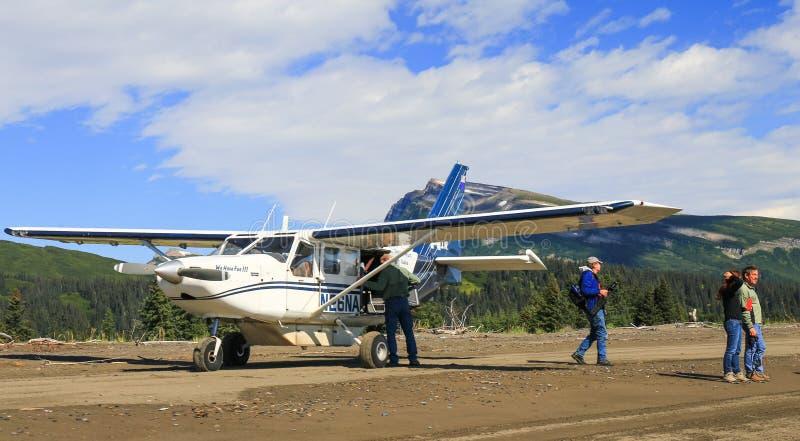 Alaska Bush Plane Beach Landing With People royalty free stock photo
