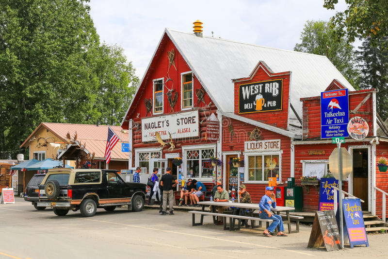 Alaska Downtown Talkeetna Shops. A view of famous Talkeetna Air Taxi, the West Rib Pub, and Nagley's Store in downtown Talkeetna, Alaska. Talkeetna, a small town stock image