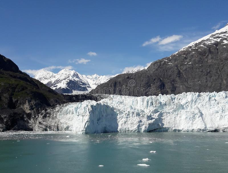 Alaska Glacier Bay glacier and snow capped mountains. Sunny, summer, travel, tourism, cruise, ice, iceberg, water stock photos