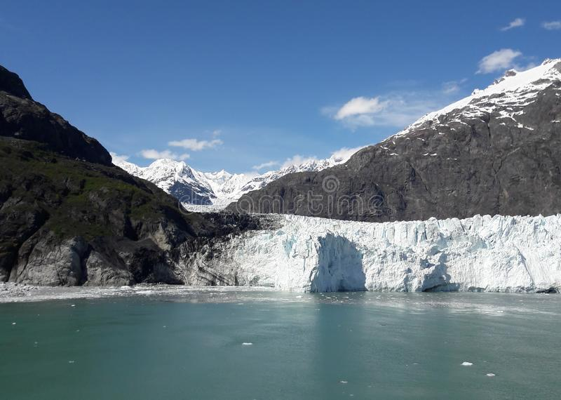 Alaska Glacier Bay glacier and snow capped mountains. Sunny, summer, travel, tourism, cruise, ice, iceberg, water stock image