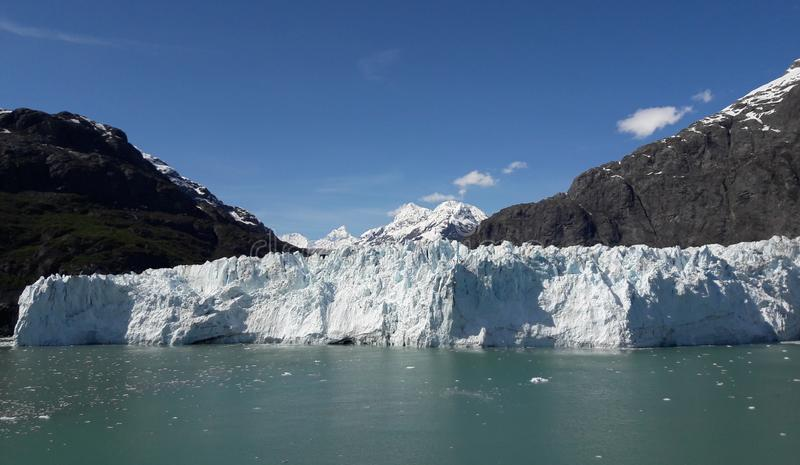 Alaska Glacier Bay glacier and snow capped mountains. Sunny, summer, travel, tourism, cruise, ice, iceberg, water royalty free stock images