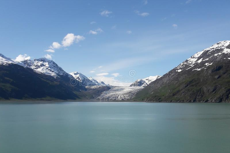 Alaska Glacier Bay glacier and snow capped mountains. Sunny, summer, travel, tourism, cruise, ice, iceberg, water royalty free stock photography