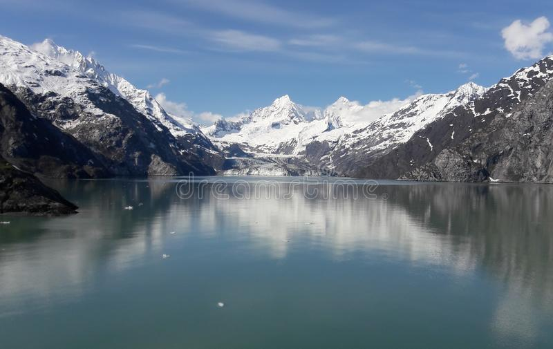 Alaska Glacier Bay glacier and snow capped mountains. Sunny, summer, travel, tourism, cruise, ice, iceberg, water stock photo