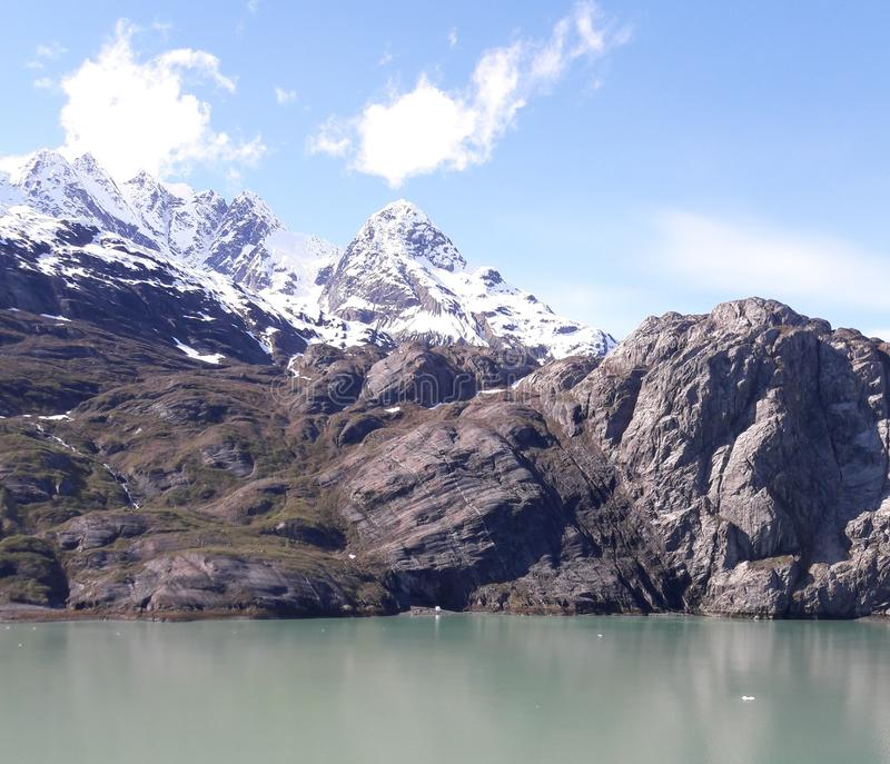 Alaska Glacier Bay glacier and snowcapped mountains. Sunny, summer, travel, tourism, cruise, ice, iceberg, water royalty free stock photos
