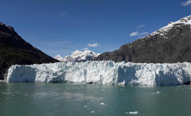 Alaska Glacier Bay glacier and snow capped mountains. Sunny, summer, travel, tourism, cruise, ice, iceberg, water royalty free stock photos