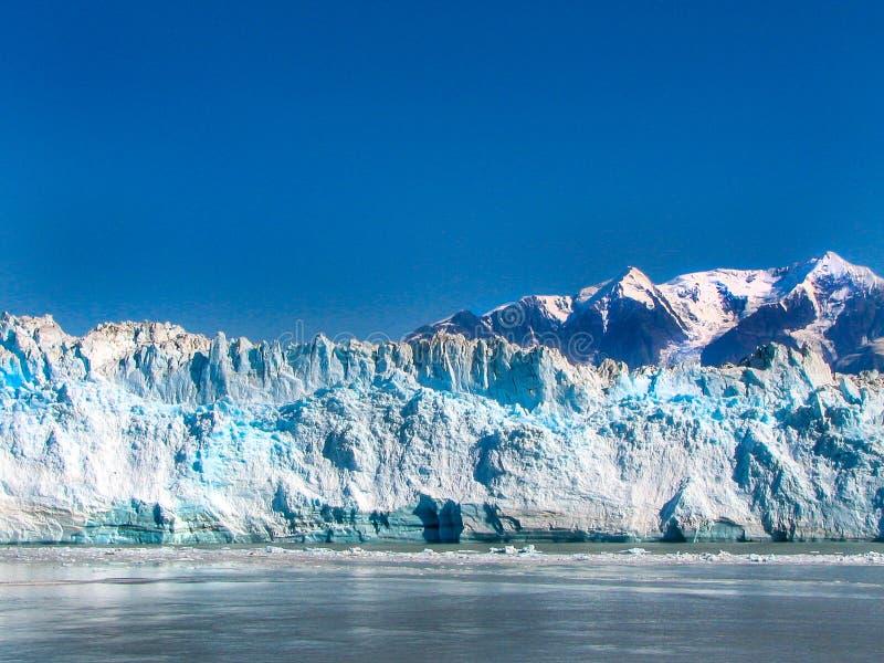Alaska Glacier Bay Hubbard Glacier. Calm waters of Alaska Glacier Bay with view of Hubbard Glacier. While spectacular, Hubbard is just one glacier, whereas stock photo