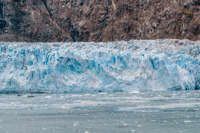 Alaska glacier front in Glacier Bay National Park. Blue Ice global warming. USA travel stock photo