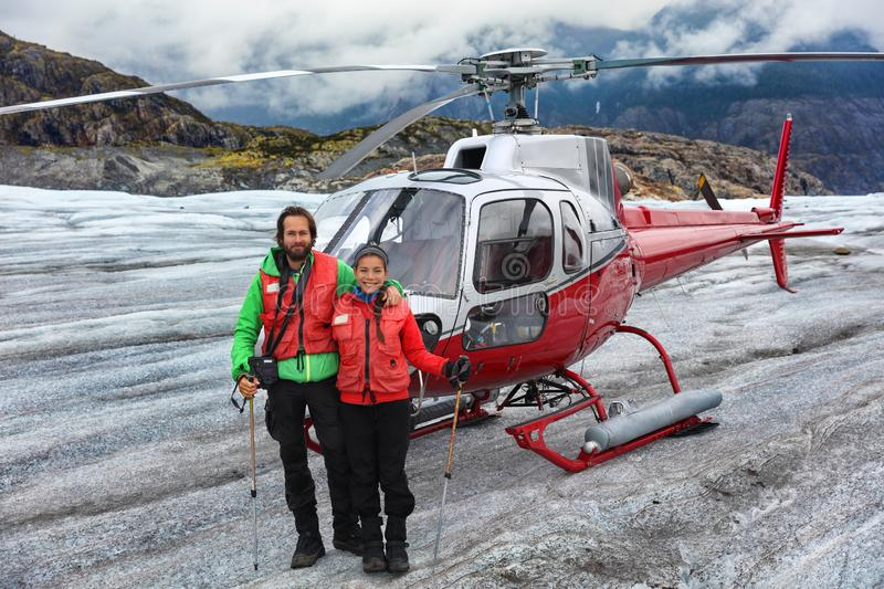 Alaska helicopter tour tourist couple on cruise excursion glacier hike activity in Skagway, Alaska, USA travel. Tourists portrait. On helicopter tour flying stock photo