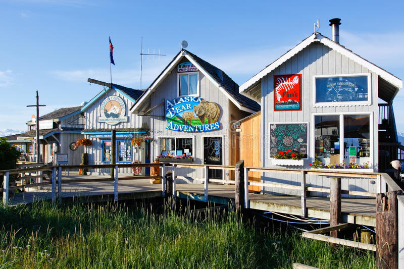 Alaska - Homer Boardwalk Tours, Food, Gifts. A view of some of the bear viewing tour offices, restaurants and gift shops along the world famous Homer Spit in royalty free stock photos
