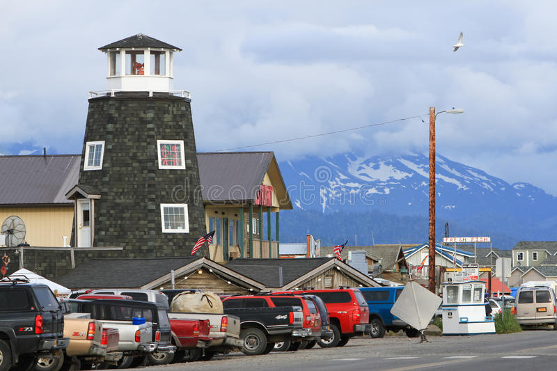 Alaska - Homer Salty Dog Saloon, Mountains. A view of world famous Salty Dog Saloon landmark on the Homer Spit in Homer, Alaska at the end of Kenai Peninsula and stock image
