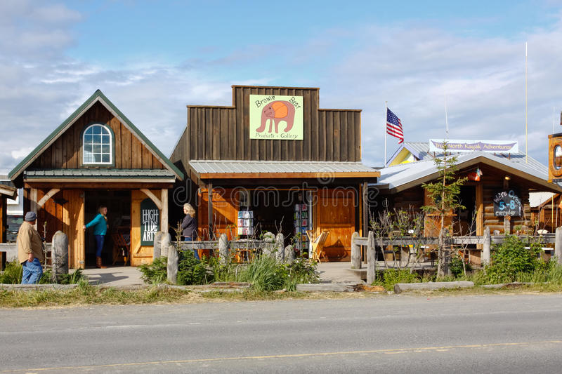Alaska - Homer Spit Shops. A view of visitors and tourists checking out some of the tour offices and gift shops along the world famous Homer Spit in Homer royalty free stock image