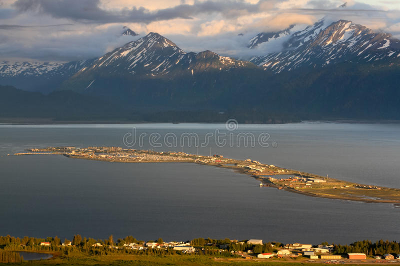 Alaska - Homer Spit at Sunset. A beautiful view of Homer Alaska, the Kenai Mountains, Kachemak Bay and the world famous Homer Spit from the overlook on East End royalty free stock images