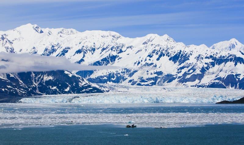 Alaska Hubbard Glacier and Mountains. A view of iceberg filled Disenchantment Bay, with Hubbard Glacier and the St. Elias Mountains in the background in Alaska royalty free stock photos