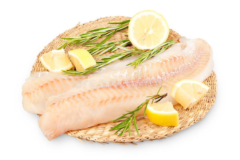 Alaska pollock fillets. With rosemary and lemon stock images