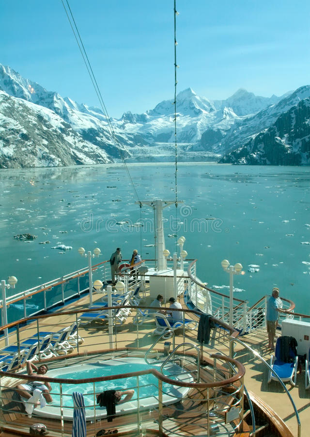 Alaska's Glacier View from Cruise Ship. GLACIER BAY, AK - JUNE 1: Passengers aboard this cruise ship enjoying the sites of Glacier Bay National Park and the royalty free stock images