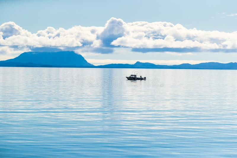 Alaska scenery tranquil scene in the morning - fisherman boat on Arctic sea in Ketchikan, USA travel. In summer royalty free stock photos