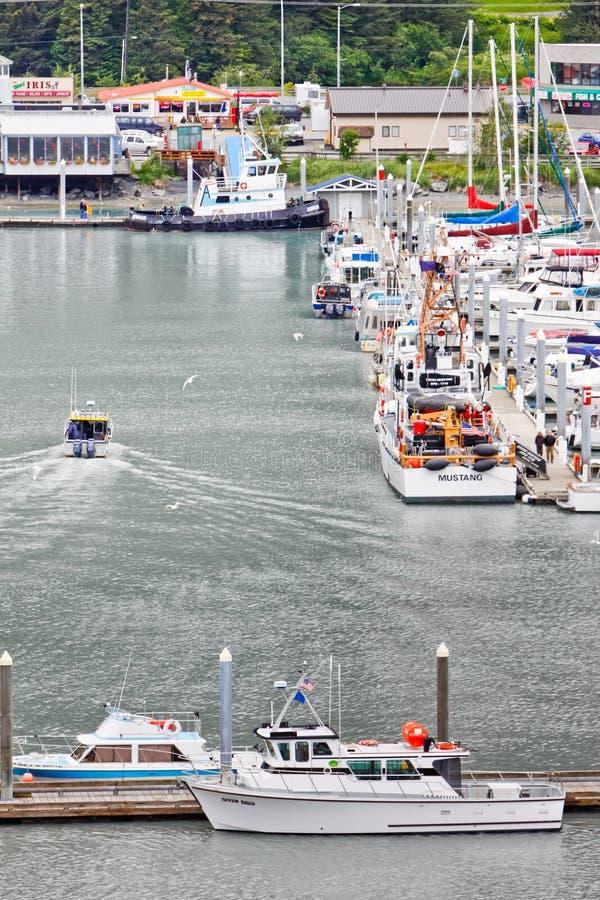 Alaska Seward Fishing Chater Boat Returns 2 royalty free stock photo