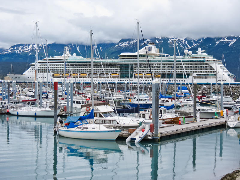 Alaska Seward Small Boat Harbor and Cruise Ship. A view of the colorful Seward Small Boat Harbor with the Royal Caribbean cruise ship Radiance of the Seas in the stock photography