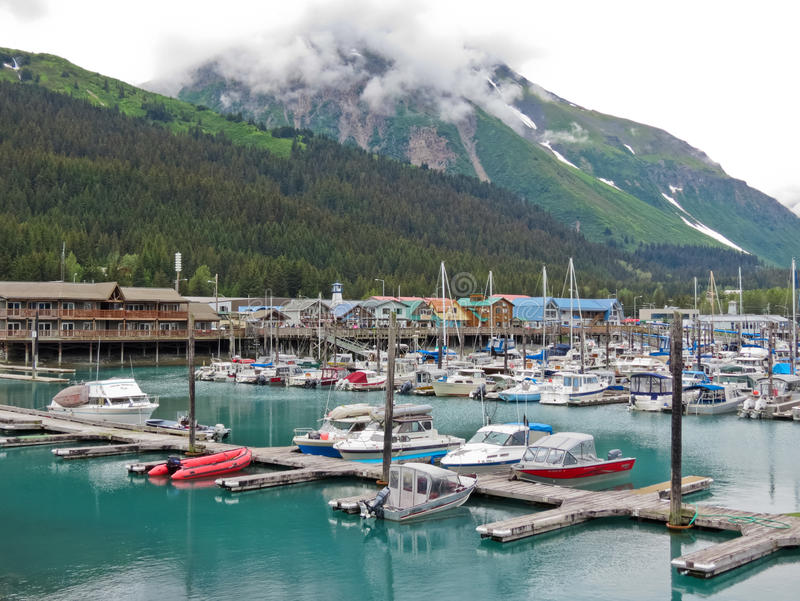 Alaska Seward Small Boat Harbor Mount Benson. A view of the Seward waterfront and a part of the Small Boat Harbor with Mount Benson nearby looming in the stock photos