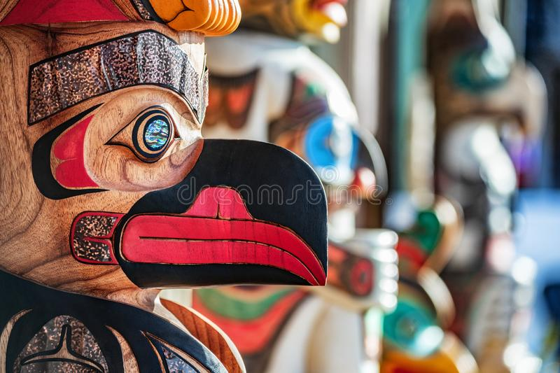 Alaska totem pole carving art sculture store in tourist travel attraction town on Alaska cruise. Ketchikan, Juneau, Skagway stores stock images