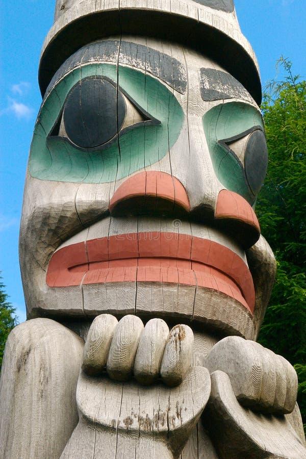 Alaska totem pole face stock photography