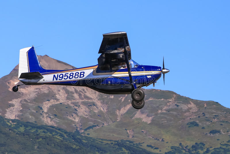 Alaskan Bush Plane Flying Blue Skies royalty free stock photos
