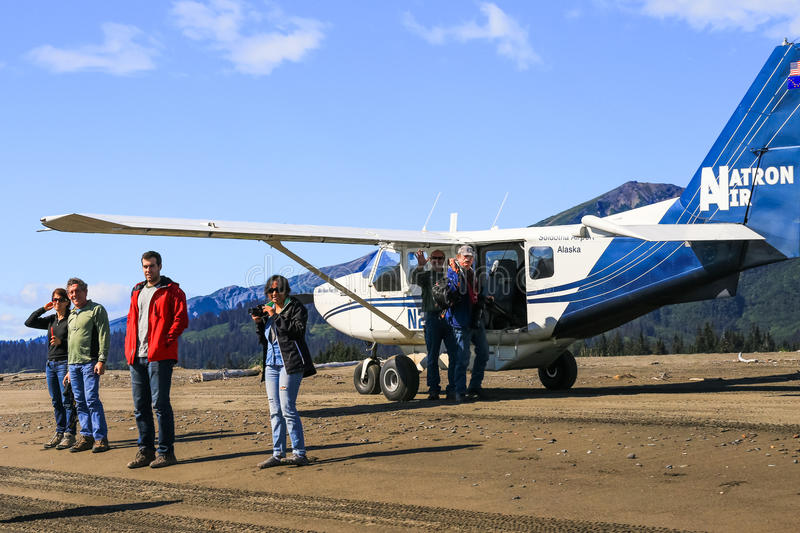 Alaskan Bush Plane With People royalty free stock images