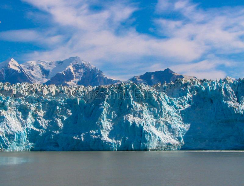 Alaskan Glacier in Blue Waters with Mountains stock photos