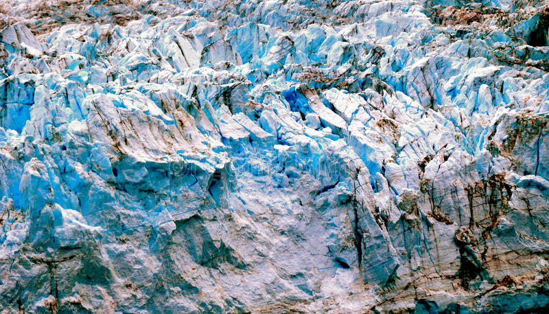 Alaskan Glaciers. With blue ice caverns royalty free stock images