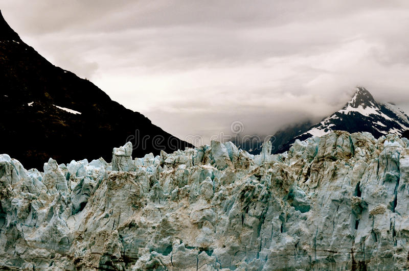 Alaskan Glaciers. With mountains and clouds stock photos
